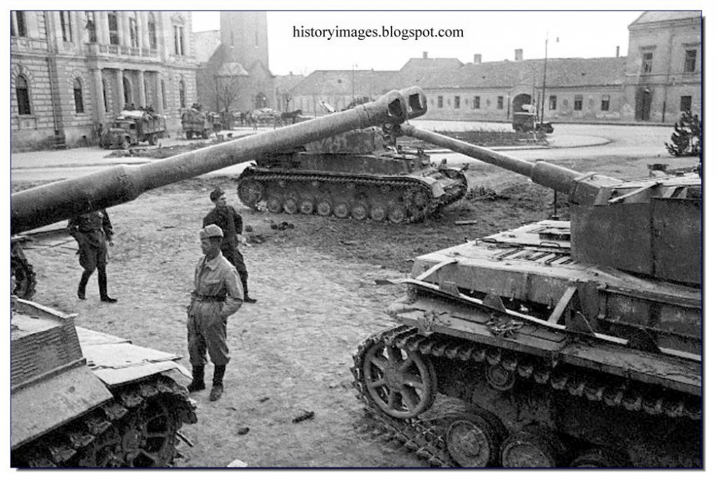 Soviet soldiers with captured German tanks